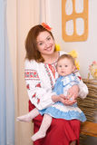 Mother and child in Ukrainian national costumes Stock Photo