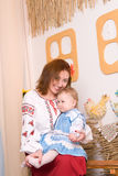 Mother and child in Ukrainian national costumes Royalty Free Stock Image
