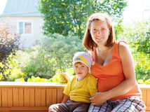 Mother and child  in veranda Royalty Free Stock Photos