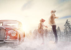 Mother, child and vintage car Stock Images