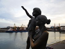Mother and child are waiting for father from a faraway sailing Stock Images