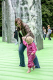 A mother and child walk on inflatable Stonehenge Royalty Free Stock Images