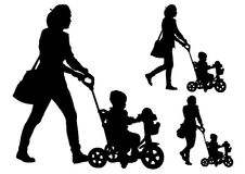 Mother with child on walk. Mother rolls the baby in the stroller for a walk Royalty Free Stock Photography