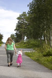 Mother and child walking. Obese mother walking with her daughter With copy space Stock Images