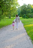 Mother and child walking Royalty Free Stock Image