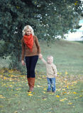 Mother and child walking Stock Photography