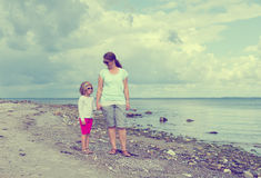 Mother and child walking on beach Royalty Free Stock Photo
