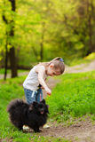 Mother and child walking playing with dog Royalty Free Stock Images