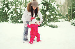 Mother and child walking in the winter royalty free stock photos