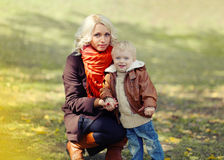 Mother and child walks in autumn Royalty Free Stock Image