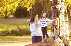 Mother and child walks in the autumn Royalty Free Stock Photography