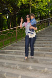 Mother with child walks down to stairs Stock Images