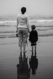 Mother and Child Watching Waves Stock Images