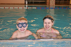 Mother with child in water Stock Photos