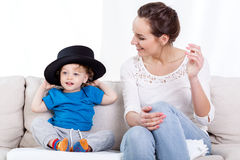 Mother and child wearing hat Stock Photo