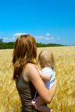 Mother with child at the wheat field Royalty Free Stock Photography