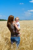 Mother with child at the wheat field Stock Photo