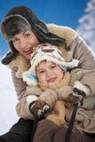 Mother and child at winter Royalty Free Stock Photos