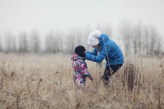 Mother with a child in winter field Stock Image