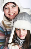 mother with child in winter hats Royalty Free Stock Image