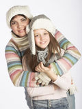 mother with child in winter hats Stock Images