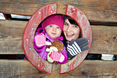 Mother and child on winter playground Stock Image