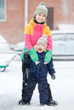 Mother with child on winter walk, positive emotions, outdoor. Snowfall, blizzard. Stock Image
