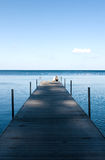 Mother and child on a wooden pier. Romantic picture of mother and child looking at the sea Stock Photos