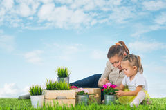 Mother and child work in garden Stock Photo