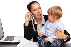 Mother and child at work series image 1. Mother and child at work series image royalty free stock image