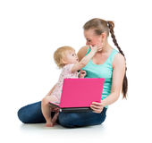 Mother with child working at laptop Stock Photos