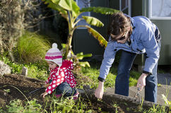 Mother and child works in the garden Stock Images