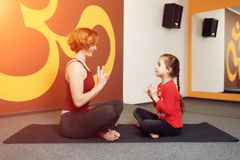 Mother and child yoga practice Stock Photos