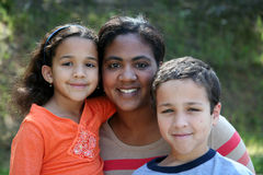 Mother and Children. A mother with her young children of a mixed race family