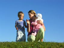 Mother with children 2. On blue sky stock photos