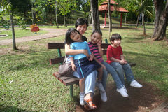 Mother and children. Having fun in the park Stock Photography