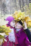 Mother and  children in autumn Royalty Free Stock Photo