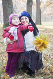 Mother and children in autumn Stock Photography