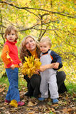 Mother with children in autumn park Royalty Free Stock Photography