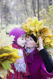 Mother and children  in autumn park Royalty Free Stock Photos