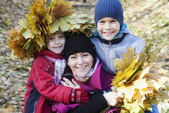 Mother and children  in autumn park Stock Photography