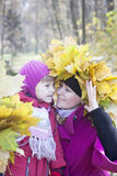 Mother and children  in autumn park Stock Photos