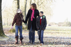 Mother And Children On Autumn Walk Stock Photo
