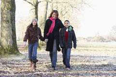Mother And Children On Autumn Walk. Smiling at camera Royalty Free Stock Image