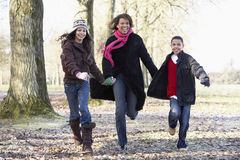 Mother And Children On Autumn Walk. Laughing at camera Royalty Free Stock Photos