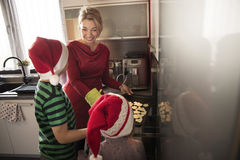 Mother with children baking cookies. royalty free stock image
