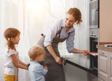 Mother with children   baking cookies Stock Images