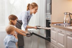 Mother with children   baking cookies Stock Image