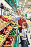 Mother and children with bell pepper in supermarket Royalty Free Stock Photos