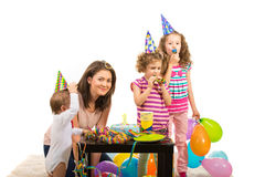 Mother and children at birthday party. Mother and her three children having birthday party and celebrate first year of boy Royalty Free Stock Images